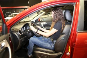 A Bulgarian woman experiences an SUV produced by Great Wall Motor Co